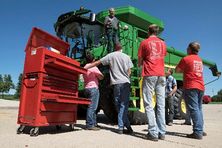 Students and John Deere combine