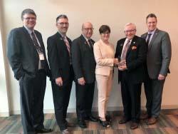 Bellevue University presents Northeast with Innovation@ Work award