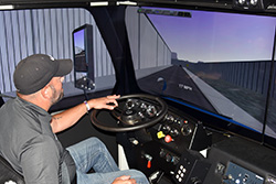 Simulator replicates real world for truck driving students